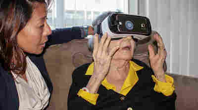 Virginia Anderlini (right) was the first private client to try out Dr. Sonya Kim's new virtual reality program for the elderly, and says she's eager to see more. Kim's handful of programs are still at the demo stage.