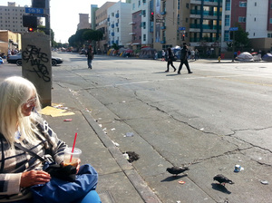 Sylvia Welker feeds the pigeons on Skid Row in Los Angeles. There are currently 47,000 homeless people in and around Los Angeles.