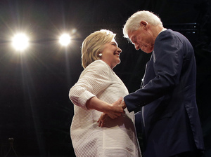 Democratic presidential candidate Hillary Clinton greets her husband, former president Bill Clinton, during a presidential primary election night rally on June 7 in New York.