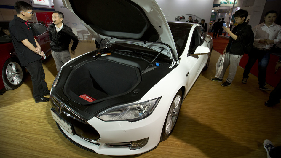 A Tesla Model S like the one seen here at an auto show earlier this year was in autopilot mode when it crashed into a tractor trailer. (Mark Schiefelbein/AP)