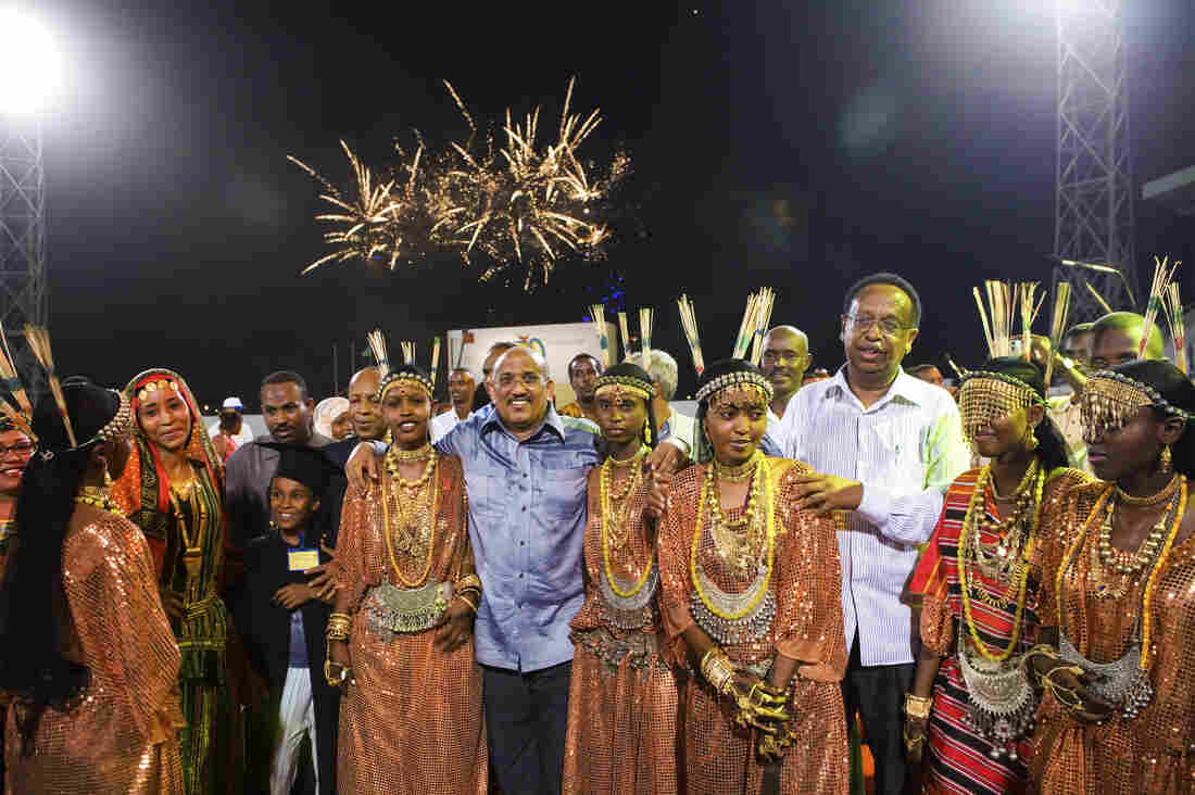 Prime Minister Dileita Mohamed Dileita, surrounded by dancers in traditional dress, celebrates the 30th anniversary of Djibouti's independence.