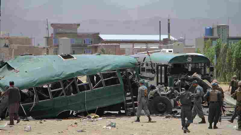 Afghan police inspect the site in in Kabul, Afghanistan, where a bus convoy was attacked on Thursday. The buses carrying police cadets were targeted as they were on their way from the neighboring Maidan Wardak province to Kabul.