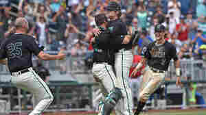 Pitcher Alex Cunningham and catcher David Parrett of the Coastal Carolina Chanticleers embrace after striking out the final batter to beat the Arizona Wildcats 4-3 to win the National Championship at the College World Series at TD Ameritrade Park in Omaha, Nebraska.