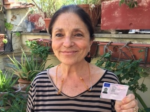 Sylvia Poggioli holds her hard-earned new Italian driver's license. After intense cramming, she aced the exam. The total cost for driving school, exam and license fees came to nearly $700.