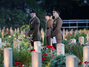 British soldiers stand among graves as they attend a vigil Thursday to commemorate the 100th anniversary of the beginning of the Battle of the Somme in northern France.