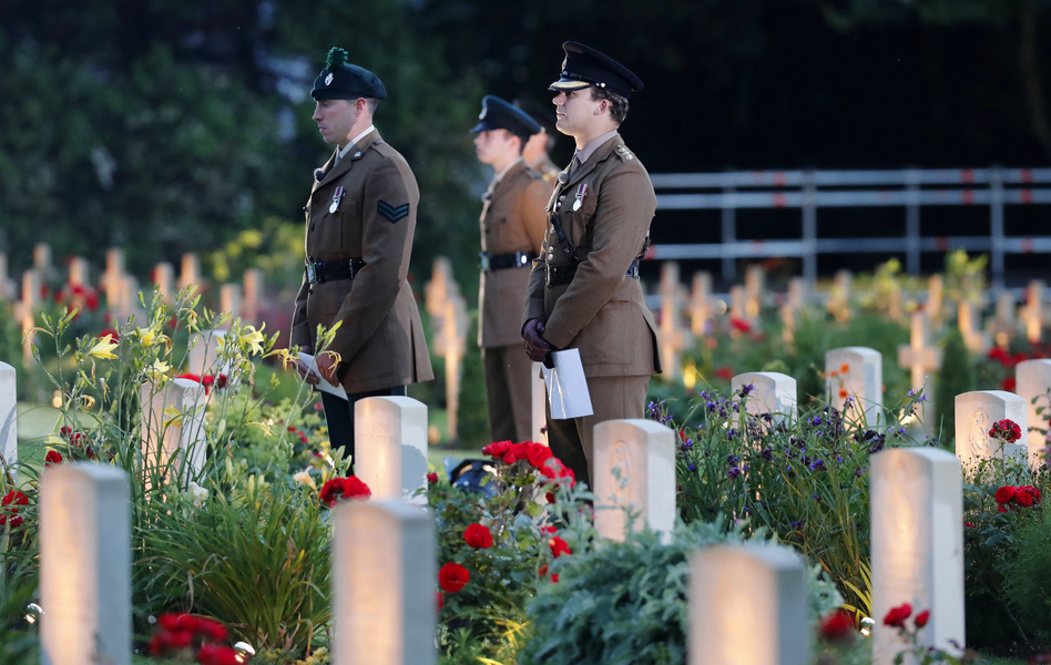 British soldiers stand among graves as they attend a vigil Thursday to commemorate the 100th anniversary of the beginning of the Battle of the Somme in northern France. (Francois Mori/AP)
