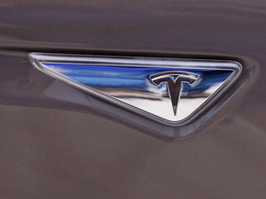 Tesla logo on the new Tesla Model S 70D during a test drive in Detroit.
