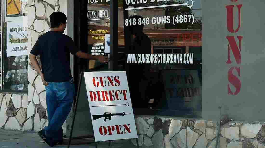 Gov. Jerry Brown signed six new bills into law Friday, nearly seven months after a mass shooting in San Bernardino, California. Two of the new laws restrict ammunition. In this photo from last summer, a man enters a gun store in Los Angeles.