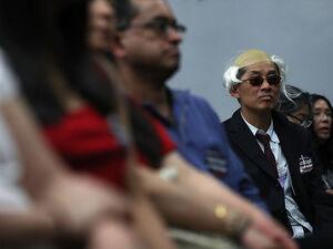 A supporter wears a costume as he watches Bernie Sanders speak in Palo Alto, California.