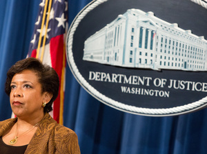 Attorney General Loretta E. Lynch listens at a press conference on June 22 in Washington, D.C.