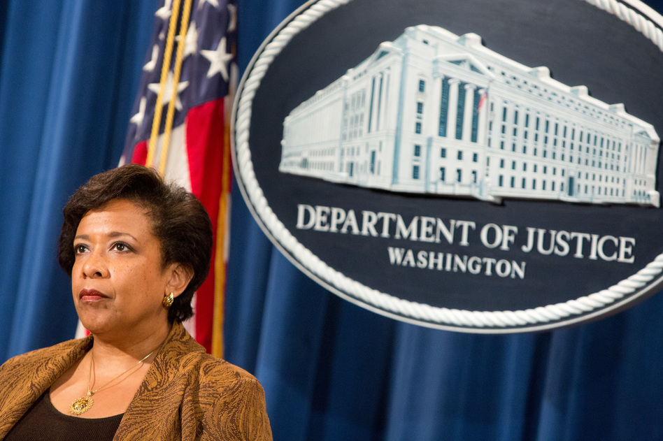 Attorney General Loretta E. Lynch listens at a press conference on June 22 in Washington, D.C. (Allison Shelley/Getty Images)