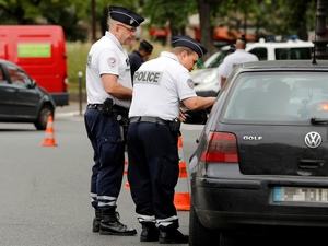 Police patrol traffic in Paris as part of new anti-pollution measures aimed at punishing vehicles registered before 1997 that are forbidden to be driven during the week. Nearly 30 police officers stood guard on the morning of July 1, in the main squares of Paris to control and raise awareness among the drivers about the new measures.