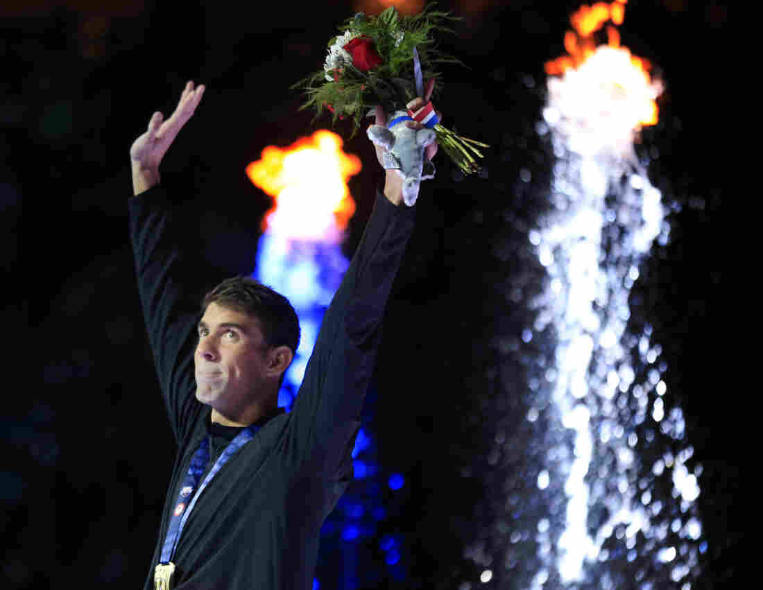Michael Phelps waves after receiving his gold medal in the men's 200-meter butterfly at the U.S. Olympic swimming trials in Omaha on Wednesday. He described it as the hardest swim of his career. With the victory, he qualified for his fifth Olympic Games, something no other male American swimmer has ever done.