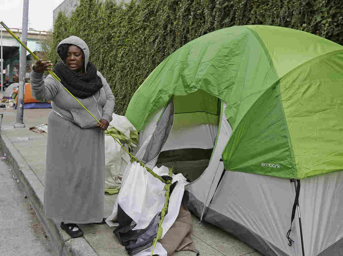 Angela Flax packs up her tent in San Francisco in February. Media outlets in San Francisco saturated Internet, broadcast and print publications this week with news stories about the city's homeless.