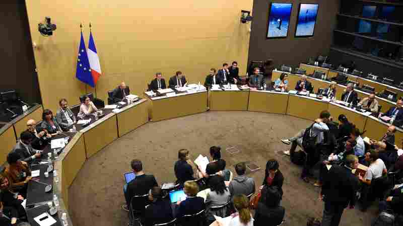 The president of the commission of inquiry, former judge Georges Fenech (center left) and Socialist lawmaker Sebastien Pietrasanta (center right) look on during a press conference in Paris on Tuesday to present the conclusions of French inquiry into the terror attacks that rocked Paris in 2015.