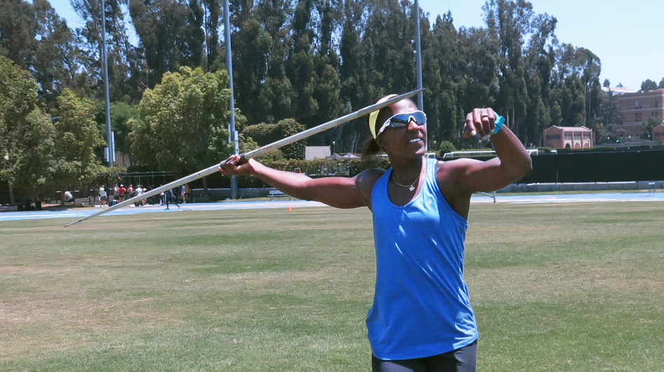 "Sharon Day-Monroe practices the javelin, one of the seven events that make up the heptathlon, at UCLA's Drake Stadium, in Los Angles, in June. ""No matter what the workout is, I always get a sick feeling in the pit of my stomach,"" Day-Monroe says. (NPR)"