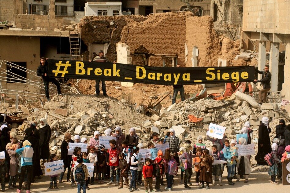 Syrian women and children stage a protest against the government's siege of Daraya, outside Damascus, on March 9. The protesters demanded that President Bashar Assad's government allow humanitarian aid into the city. (Anadolu Agency/Getty Images)