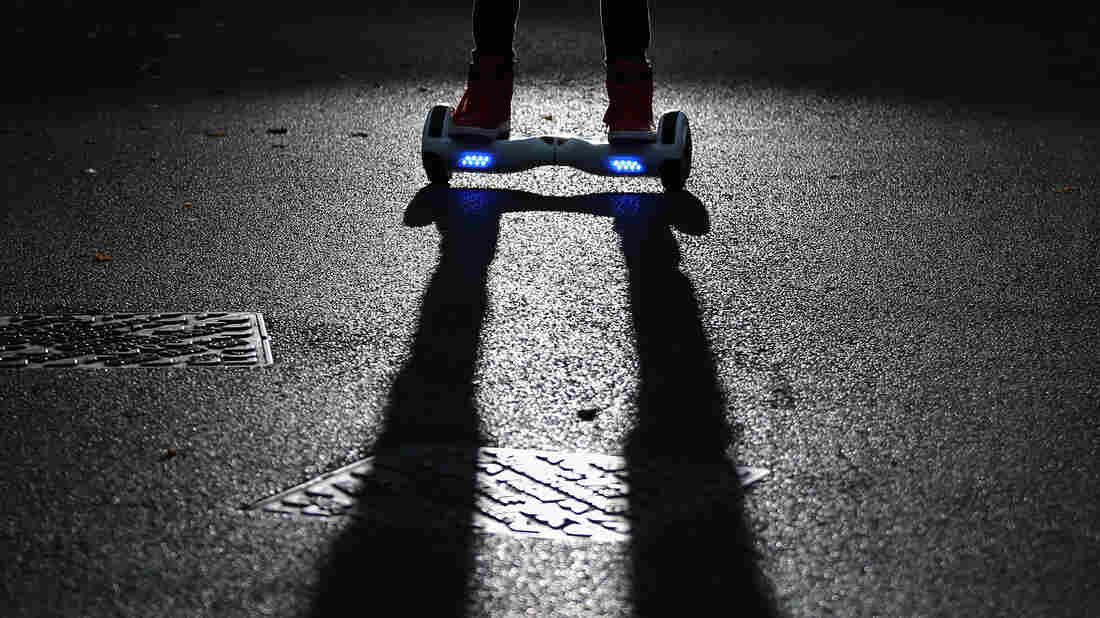 A youth poses as he rides a hoverboard, which is also known as a self-balancing scooter and balance board, on October 13, 2015 in Knutsford, England. More than half a million of the devices have been recalled in the United States, after nearly 100 instances of the boards catching fire.
