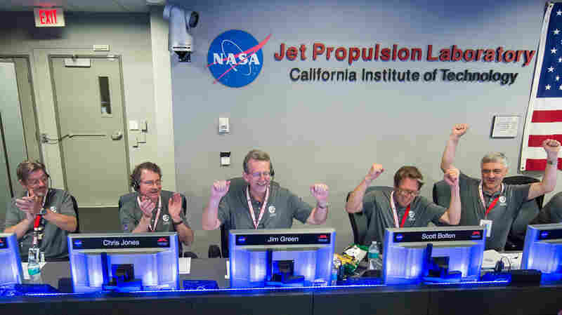 Members of the Juno team celebrate at the Jet Propulsion Laboratory in Pasadena, Calif., after they receive confirmation from the spacecraft that it successfully completed the engine burn and entered the orbit of Jupiter on July 4.