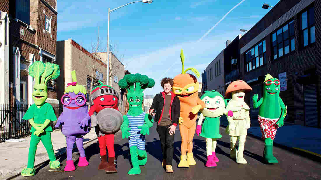Sammy Spinach (far left), Erica Eggplant, Todd Tomato and other characters in the Super Sprowtz gang with Roger, the super hero trainer (center).