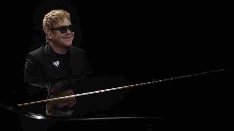 "Elton John performing his song ""A Good Heart."""