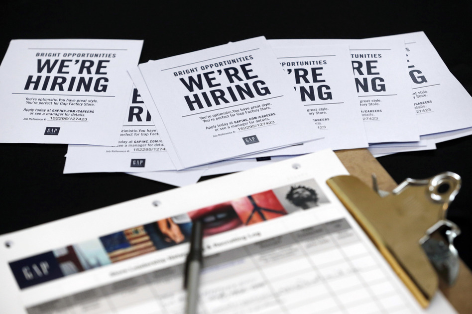Job applications and information for the Gap Factory Store sit on a table during an October job fair at Dolphin Mall in Miami. (Wilfredo Lee/AP)