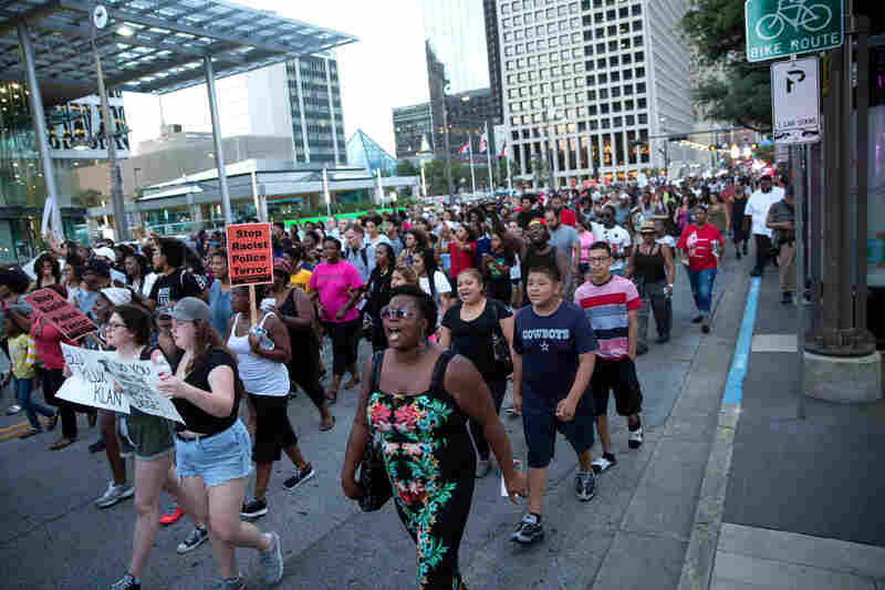 People rally in Dallas on Thursday to protest the deaths of Alton Sterling and Philando Castile.