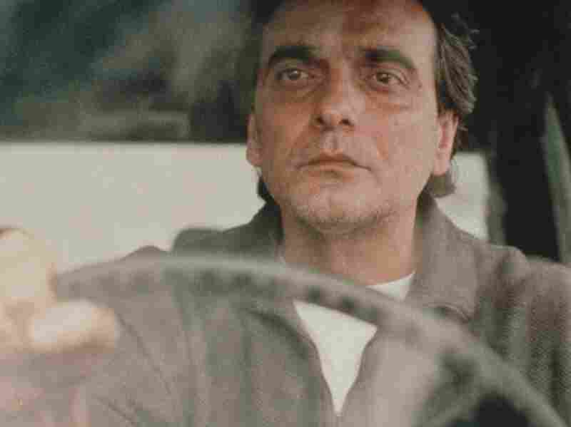 Kiarostami's Taste of Cherry won the Palme d'Or at the 1997 Cannes Film Festival. It follows a man (Homayoun Ershadi) who is contemplating suicide and drives around Tehran looking for someone to bury him.