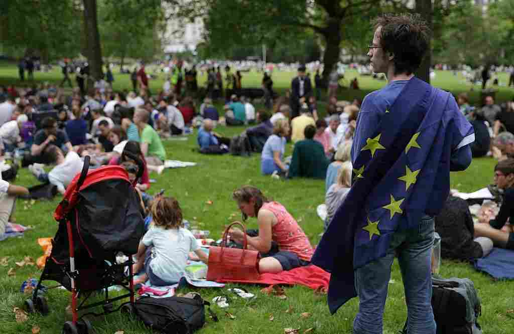 A European Union supporter stands with a European Union flag during a picnic against Brexit in London's Green Park on Saturday.