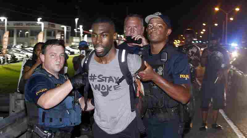 Police arrest activist DeRay McKesson during a protest along Airline Highway, a major road that passes in front of the Baton Rouge Police Department headquarters on Saturday in Baton Rouge, La.