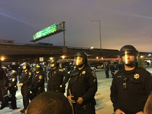 Police officers in Oakland, Calif., line up across from demonstrators on July 7 as protesters marched against police shootings in Louisiana and Minnesota.
