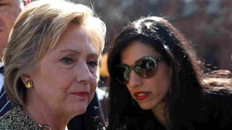 NEW YORK, NY - APRIL 17: Democratic presidential candidate former Secretary of State Hillary Clinton (L) talks with aide Huma Abedin (R) before speaking at a neighborhood block party in the Brooklyn borough of New York City.