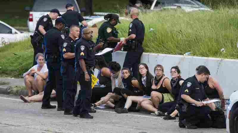 BATON ROUGE, LA -JULY 10: Several arrested protesters get processed on the scene after a march on July 10, 2016 in Baton Rouge, Louisiana.