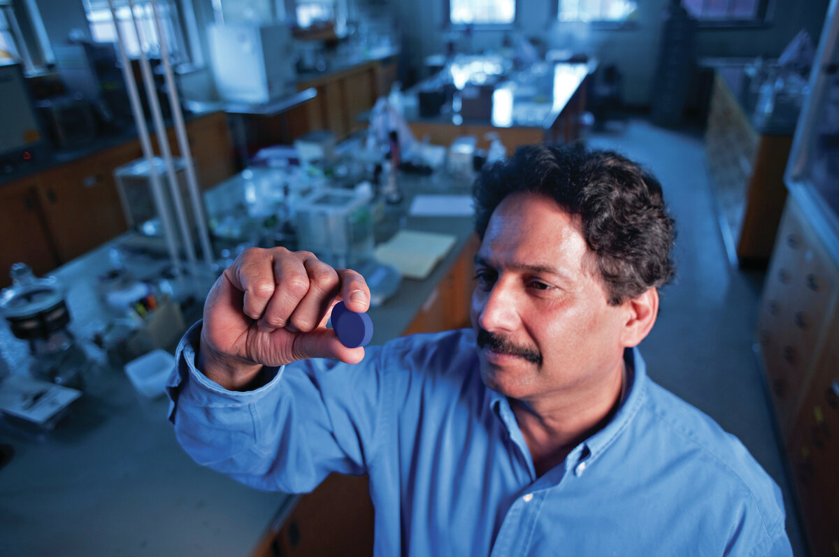 Professor Mas Subramanian looks at the blue pigment that was discovered at his lab in Oregon State University.