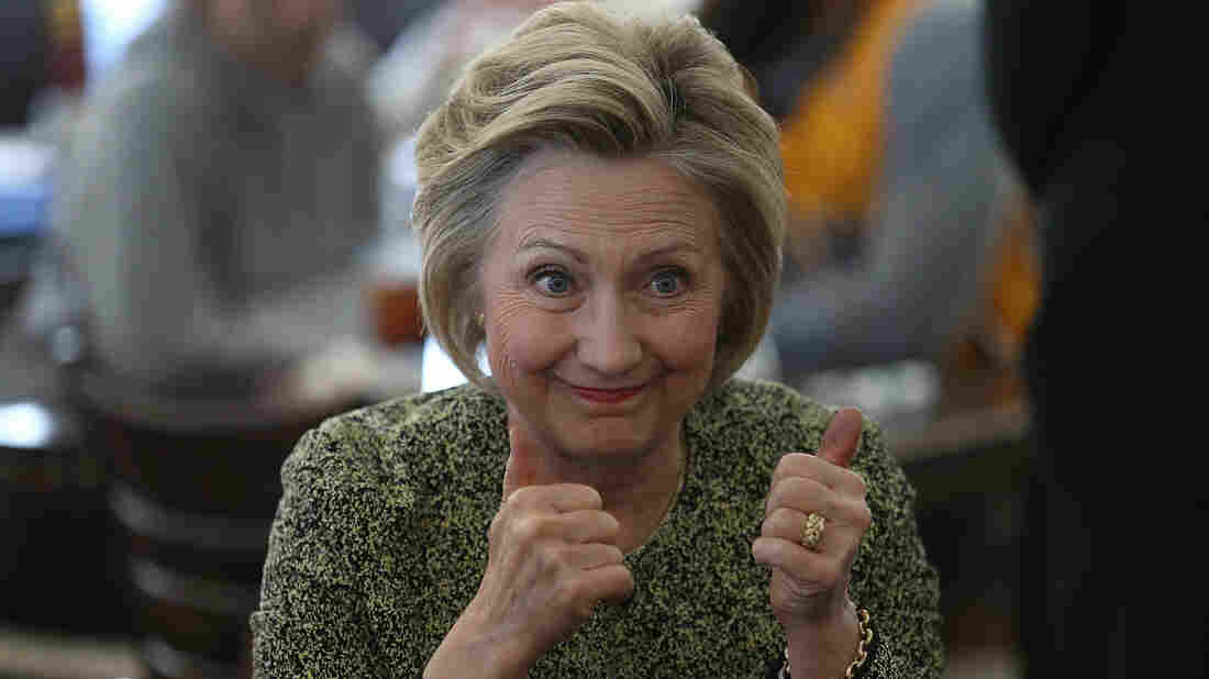 Hillary Clinton gives a thumbs up during a stop at the Lincoln Square pancake house while campaigning in May in Indianapolis.