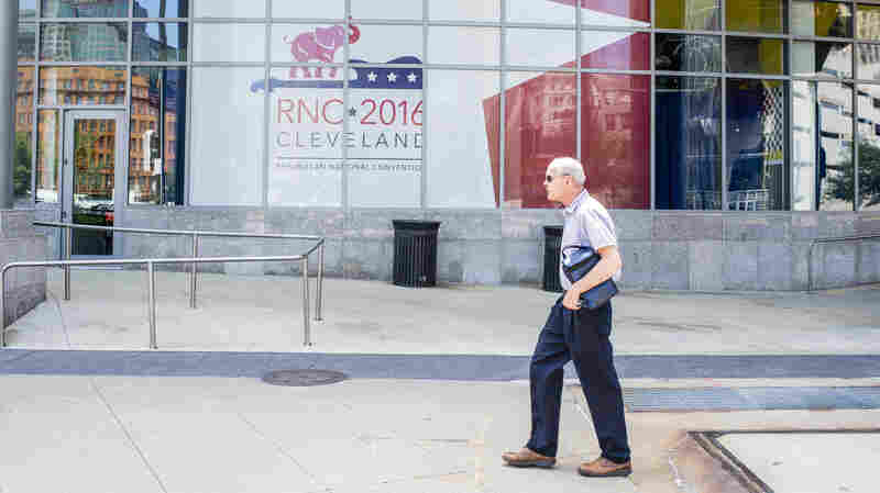 An unidentified man walks past the Quicken Loans Arena on July 11, 2016 in Cleveland, Ohio.