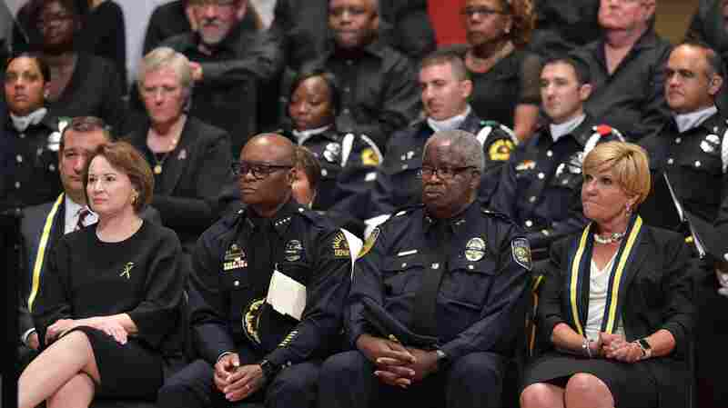 Dallas Police Chief David Brown (second from left) and Dallas Area Rapid Transit Police Chief James Spiller (second from right) attend an interfaith memorial service for the victims of the Dallas police shooting.