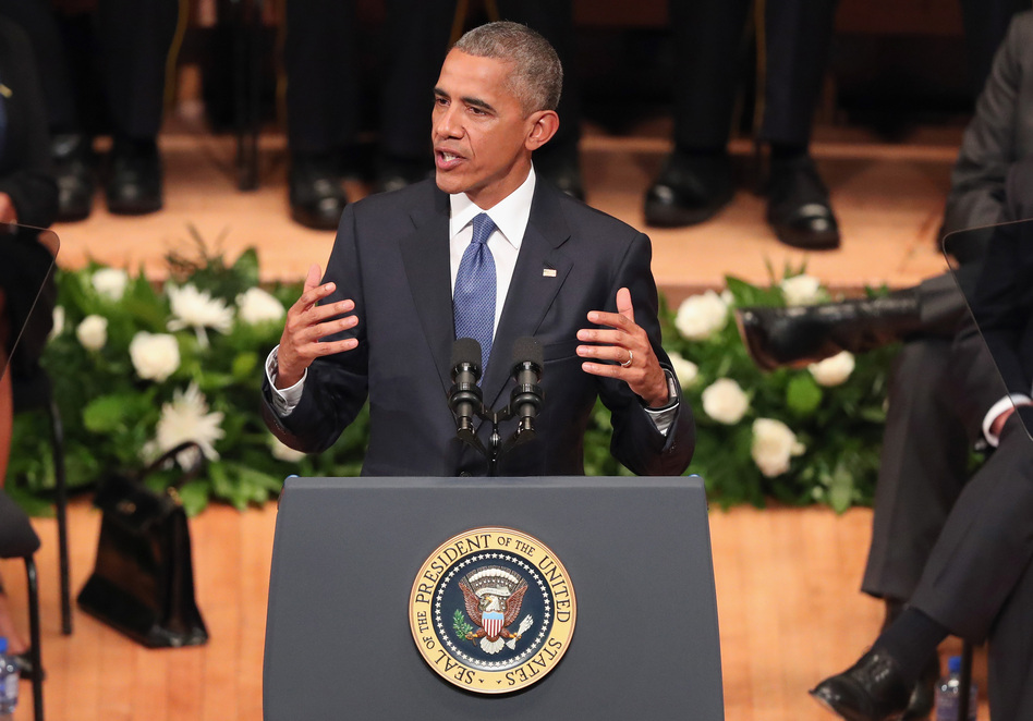 President Obama delivers remarks during an interfaith memorial service honoring five slain police officers, Tuesday at the Morton H. Meyerson Symphony Center in Dallas. (Tom Pennington/Getty Images)