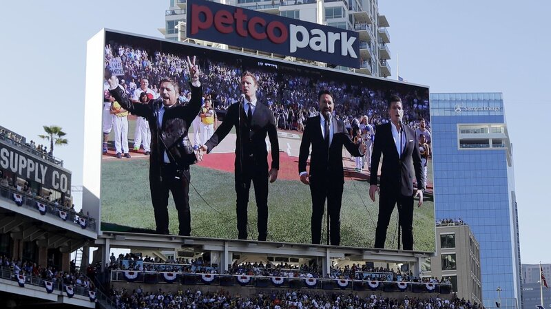 The Tenors, shown on the scoreboard, perform the Canadian national anthem prior to the MLB baseball All-Star Game on Tuesday.