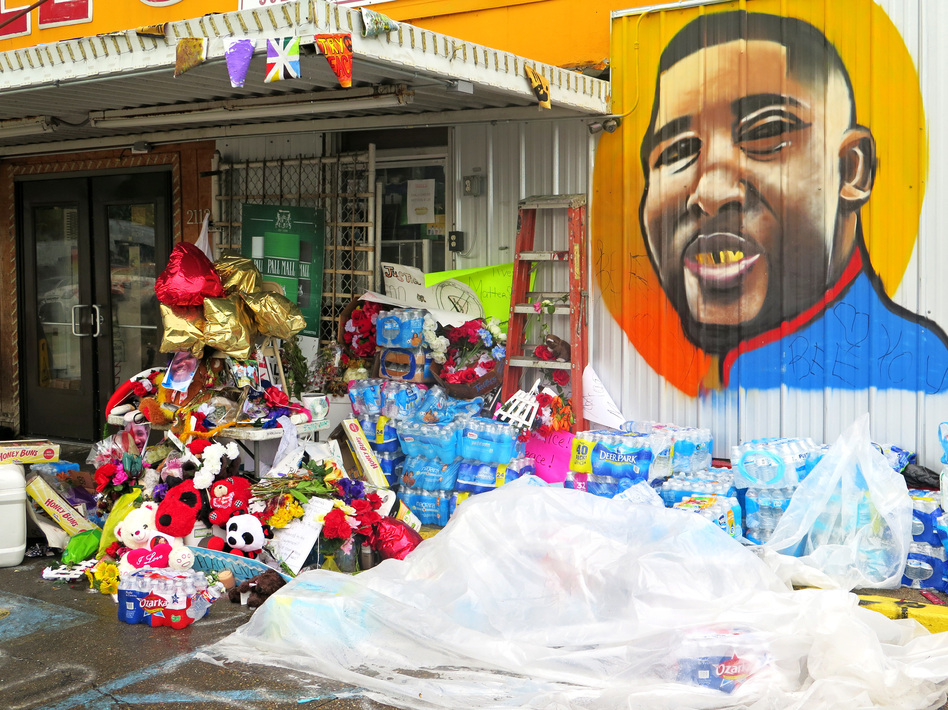A memorial for Alton Sterling at the Triple S Food Mart in Baton Rouge. Sterling was fatally shot by a Louisiana police officer last week. (Greg Allen/NPR)