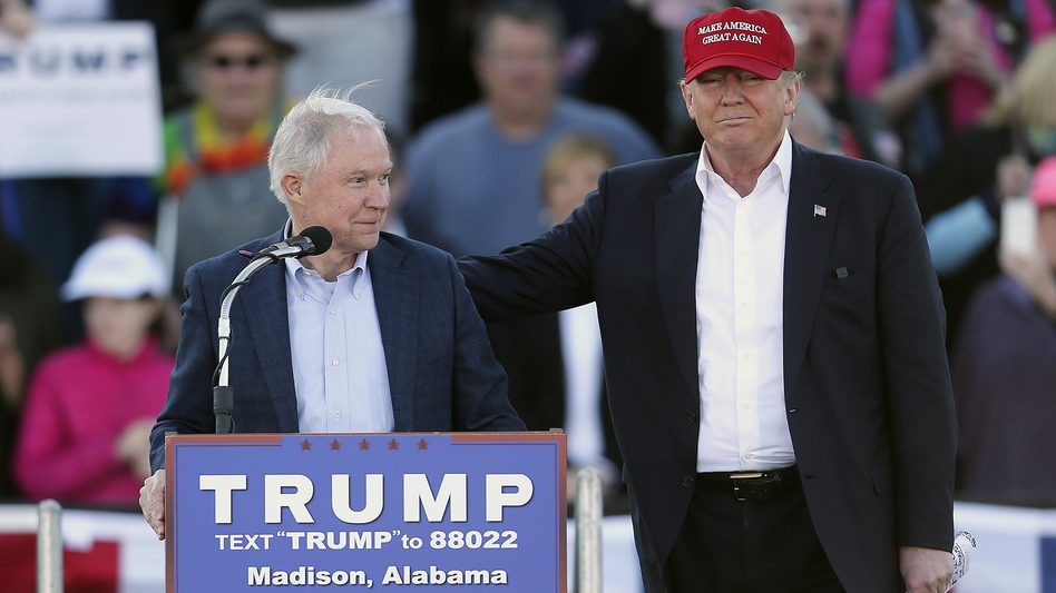 Republican presidential candidate Donald Trump, right, stands next to Sen. Jeff Sessions during a rally in Madison, Ala. on Feb. 28. (John Bazemore/AP)