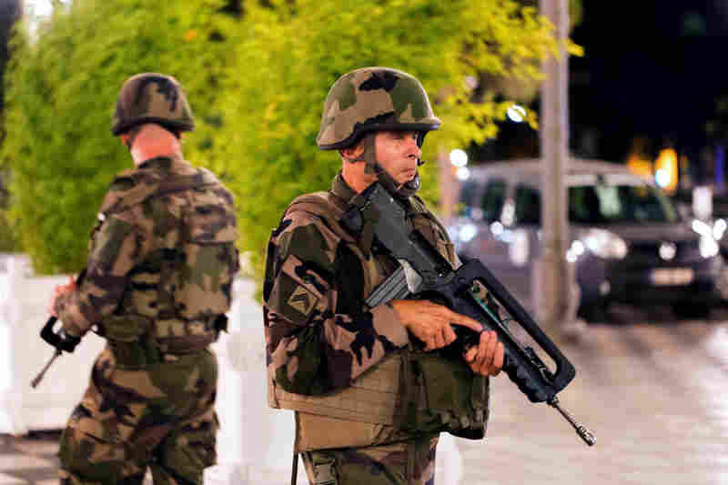 Soldiers stand guard by the sealed-off area of the French resort city of Nice on Friday.