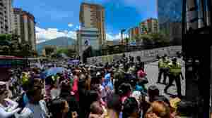 People line up to buy groceries outside a supermarket in Caracas, Venezuela's capital, on July 13. The State Department issued a travel warning for the country on July 7. Four other countries have been the subject of U.S. travel warnings since July 1.