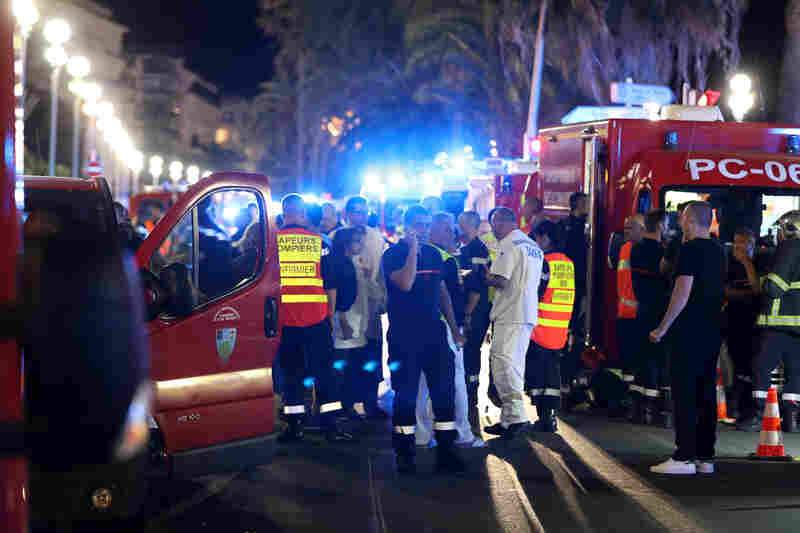 Police officers, firefighters and other rescuers work at the Promenade des Anglais in Nice after a truck drove into a crowd watching Bastille Day fireworks in the French Riviera resort city.