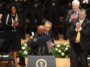 President Barack Obama hugs Dallas Police Chief David Brown during a memorial service for the police officers killed in Dallas last week.