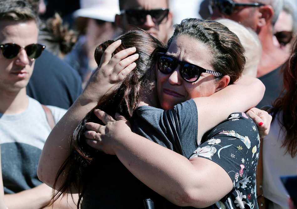 Women react near the scene of Thursday evening's attack in Nice. (Francois Mori/AP)