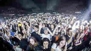 Throngs of fans hold up cell phones during a Disclosure concert earlier this year.