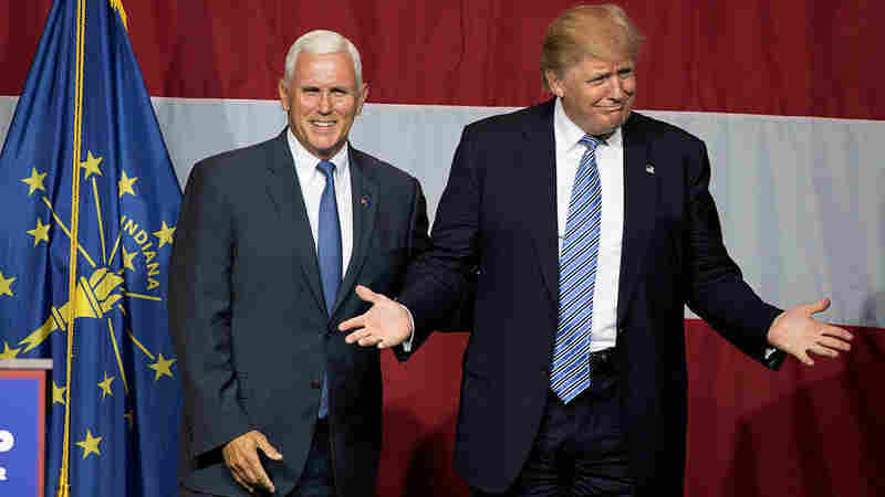 Presumptive Republican presidential candidate Donald Trump (right) and Indiana Gov. Mike Pence take the stage during a campaign rally at Grant Park Event Center in Westfield, Ind.
