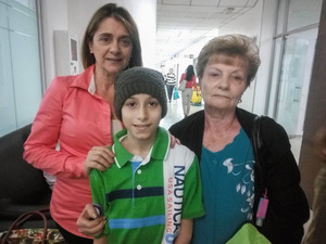Hugo d'Alessandro is pictured with his mother and grandmother. He was diagnosed with cancer when he was 10 years old. Treatment is difficult in Venezuela; his mother says the drugs he needs aren't always available.