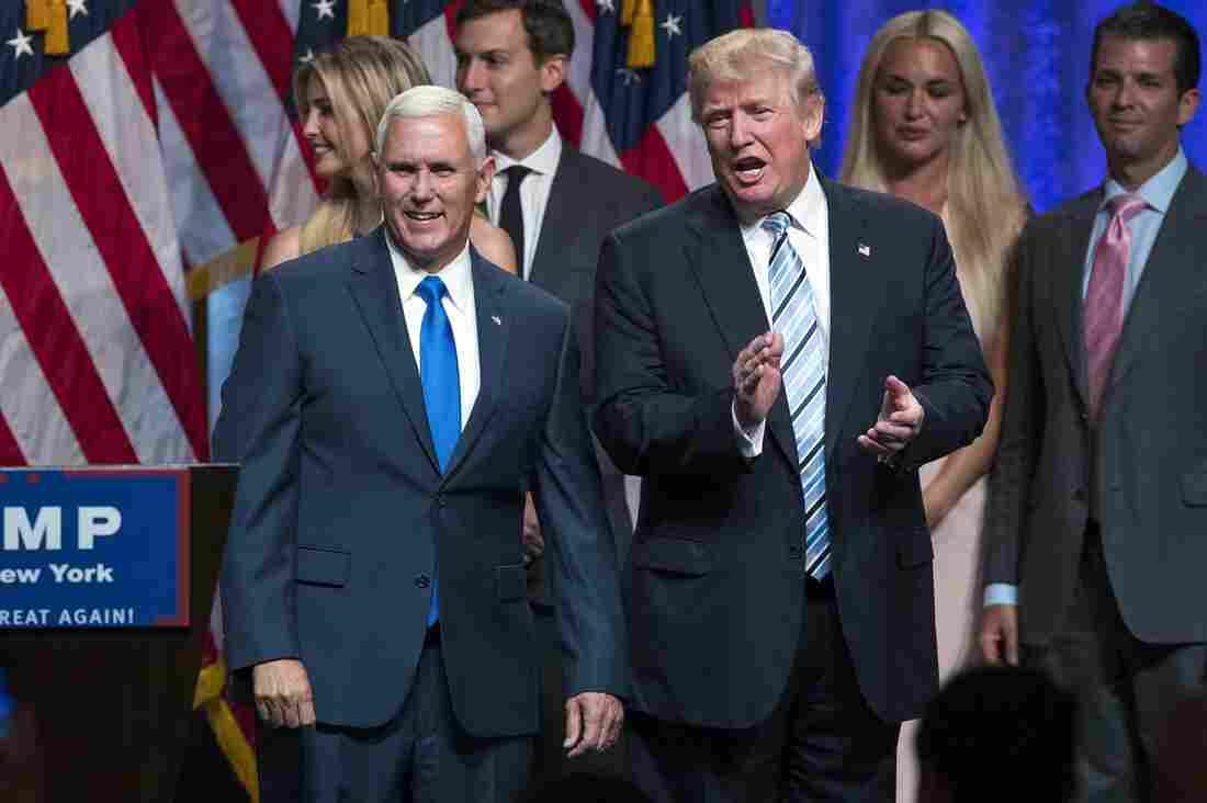 Republican presidential candidate Donald Trump (right) introduces Gov. Mike Pence, R-Ind., during a campaign event to announce Pence as his vice presidential running mate on Saturday.